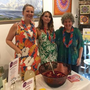 Left to Right: Katherine Clark, Nina Bays, and Amy Grant (gallery owner) hosting fundraiser at Art in Bloom Gallery for the Cape Fear Literacy Council